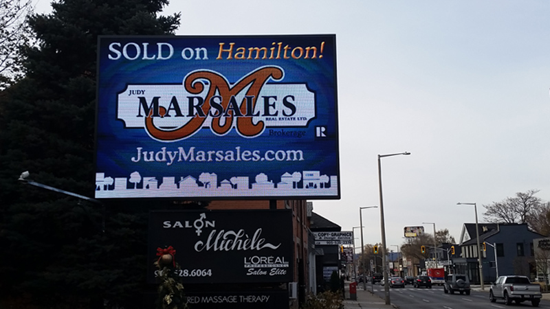 Photo of Judy Marsales Billboard Sign on King Street West at Ray Street in Hamilton ON