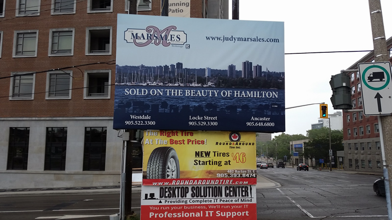 Photo of Judy Marsales Billboard Sign at corner of Caroline and Main Streets in Hamilton ON