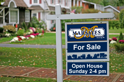 Photo of Home with Judy Marsales For-Sale sign on the lawn