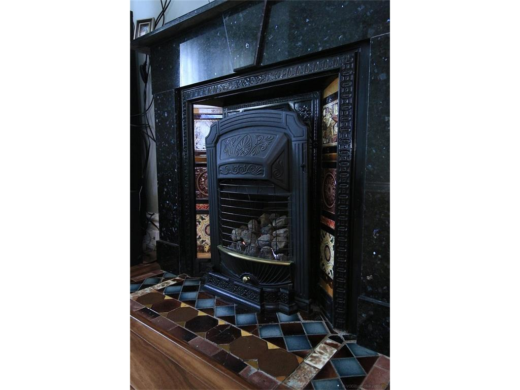 226 Queen Street S  - Living Room Fireplace - original quartz mantle with intricate tile inlay