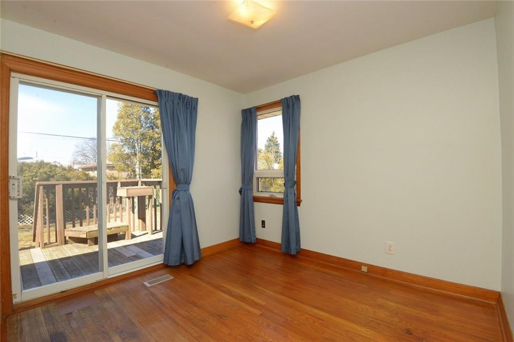 324 East 34th Street - Second bedroom has patio doors leading to the deck that overlooks the private back yard.