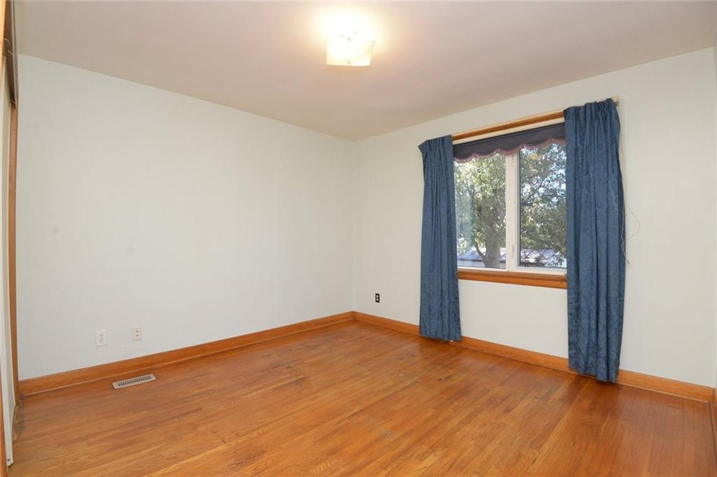 324 East 34th Street - Master bedroom with a large upgraded window overlooking the rear yard