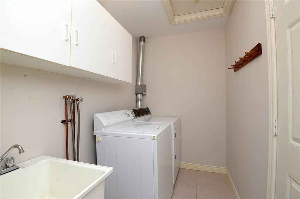 14-60 Dundas Street - Main floor laundry room. Also provides access to garage.
