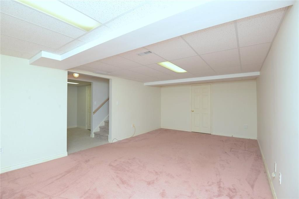 14-60 Dundas Street - Large rec room. Door at rear leads to another room of similar size that's used for storage at present, but could easily be finished for additional living space.